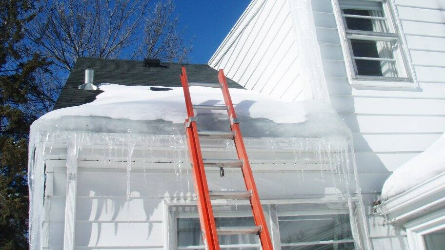ice dam on roof with ladder