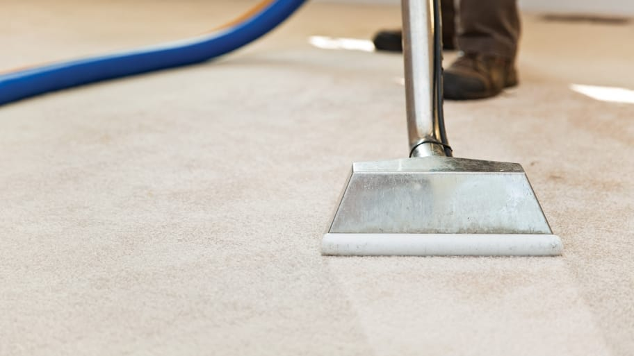 technician using carpet cleaning machine