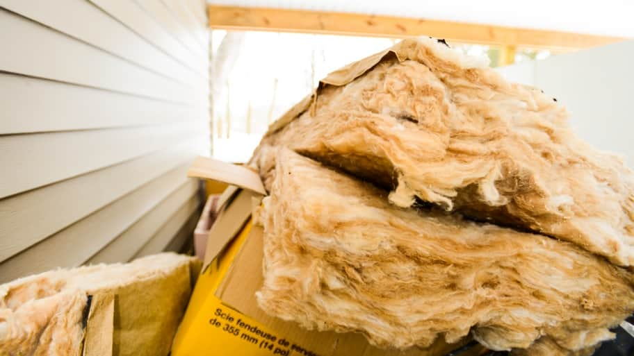 insulation piled outside a home