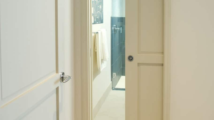 white interior bathroom pocket door