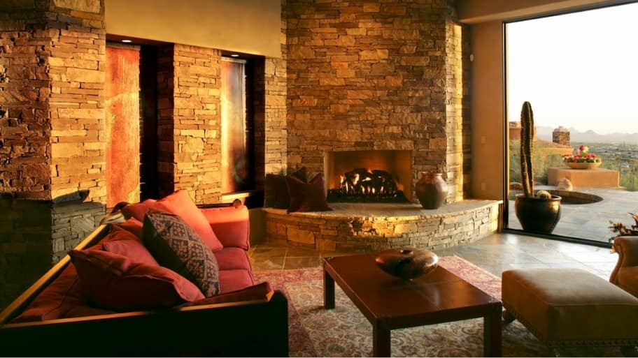 interior with stone walls and a fireplace