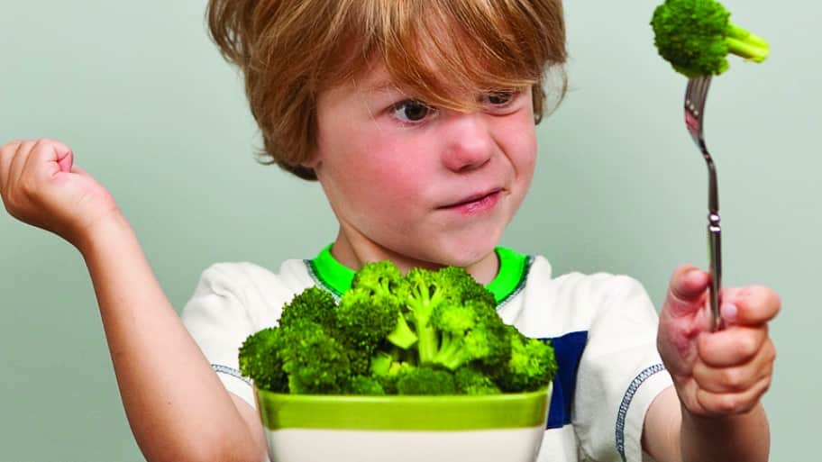 kid with a bowl of broccoli