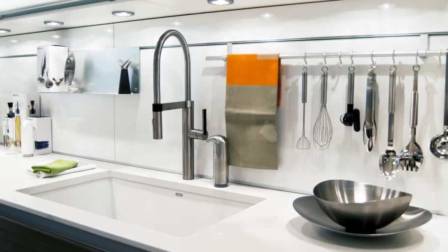Kitchen Countertop Storage Ideas Part - 48: Utensils Hanging On A Rod Over A Kitchen Counter