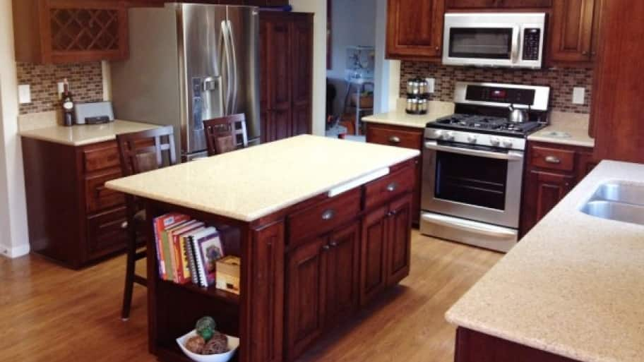 after refinishing the cabinets adding backsplash and installing new appliances did the trick