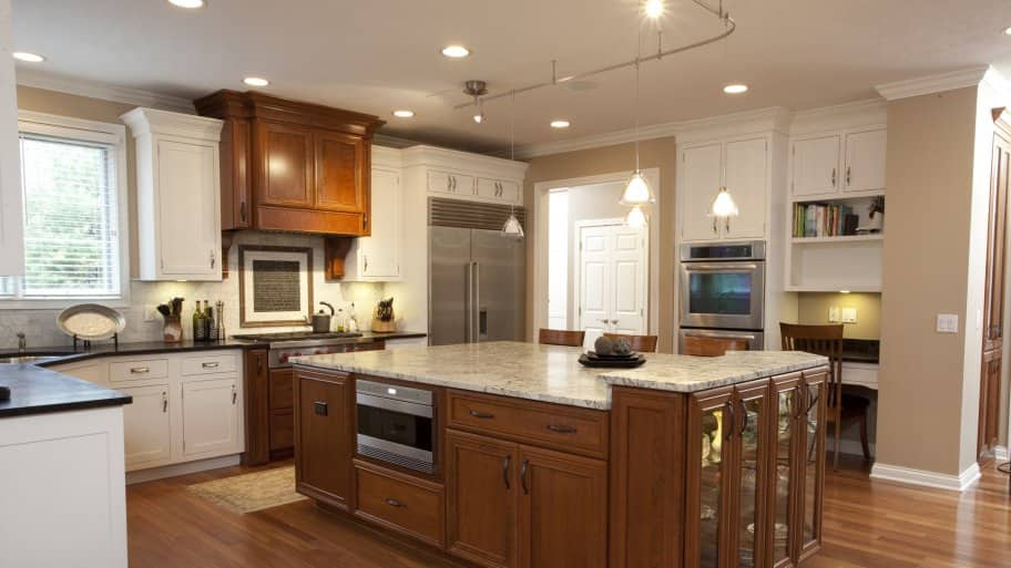 can, pendant, under cabinet and track lighting in kitchen