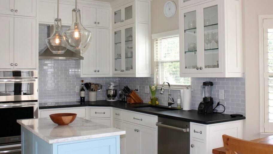 Complete Kitchen Remodel With Light Fixture And Tile Backsplash