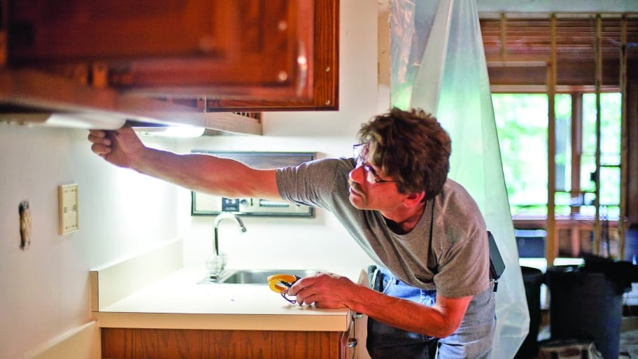 electrician checking lights during a kitchen remodel