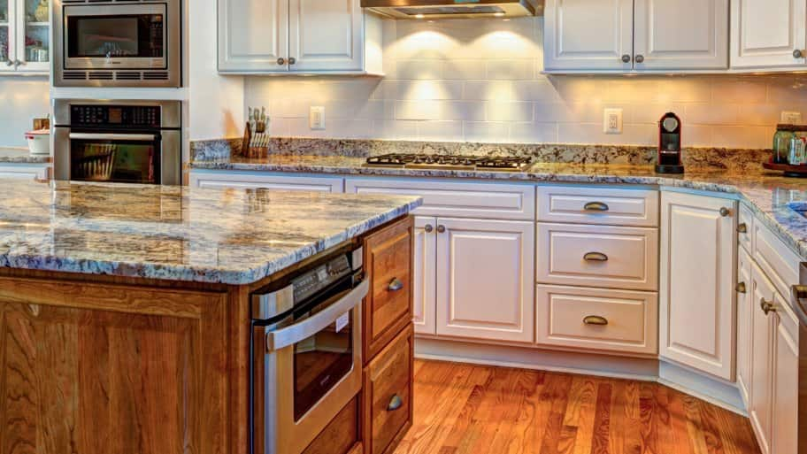 Kitchen Remodel With White Cabinets And Granite