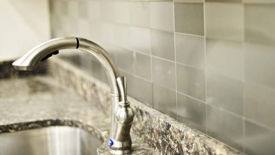 Silver kitchen faucet