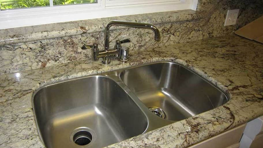 double-bowl sink under-mounted in granite countertop