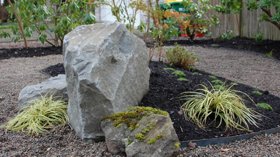 boulders in a residential lawn