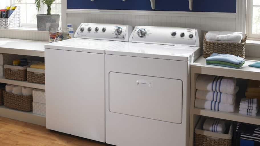 washer and dryer with shelves beside and above