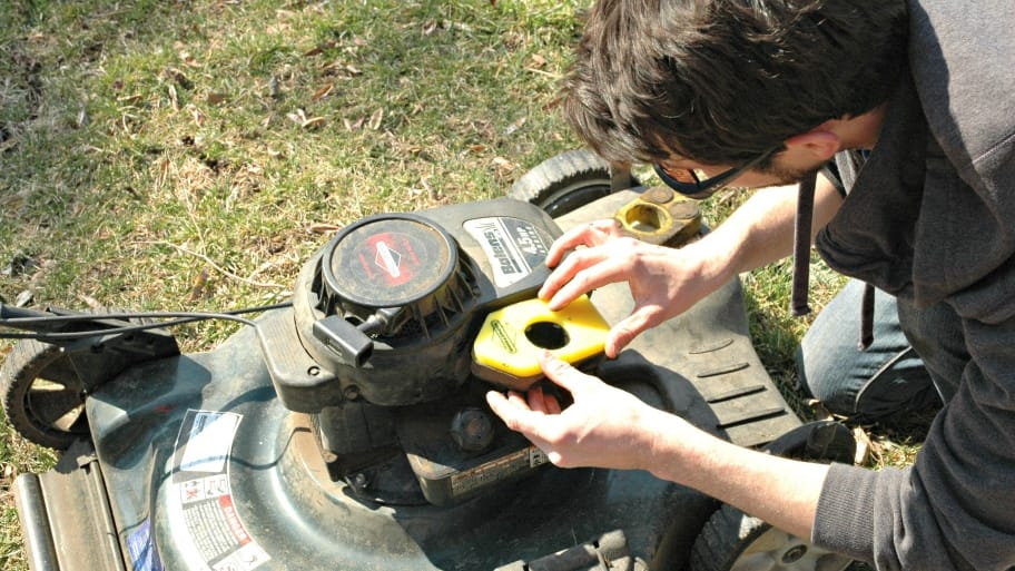 lawn mower being fixed