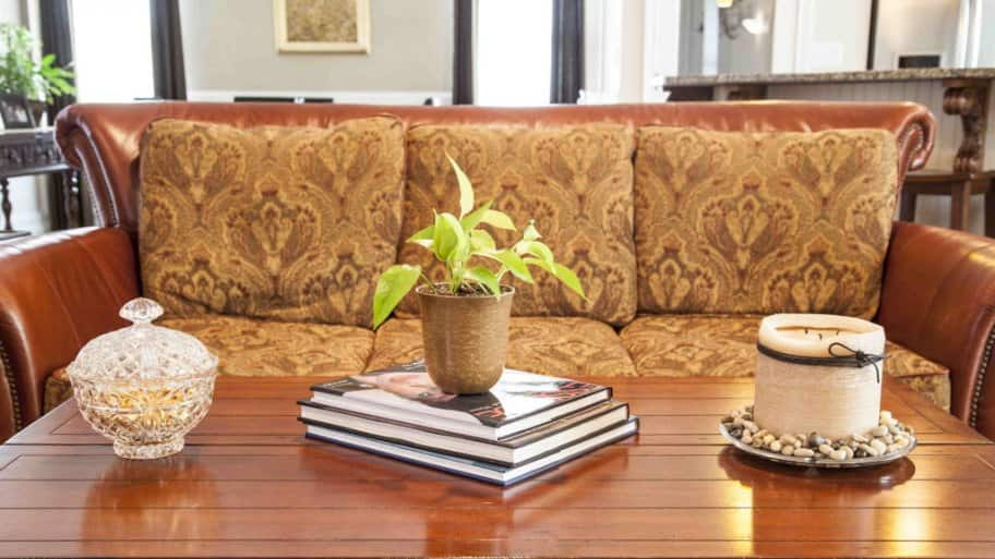 leather couch and coffee table - How To Stage Your Home