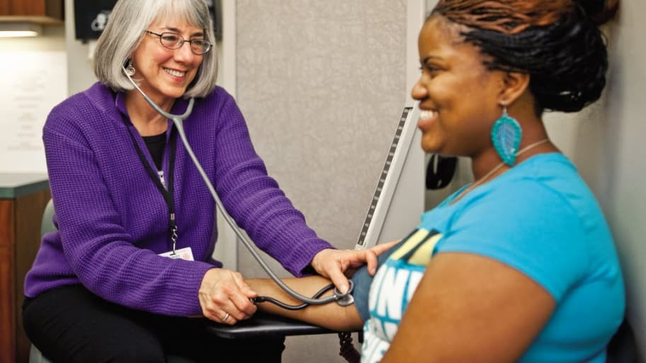 A woman has a blood pressure check
