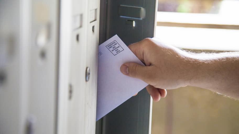 man taking bulk mail from mailbox