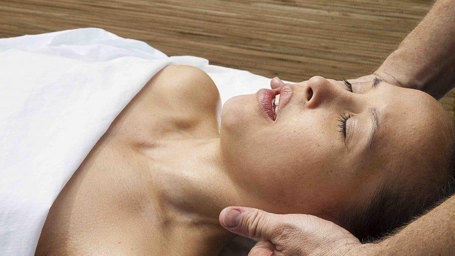 woman getting massage by massage therapist