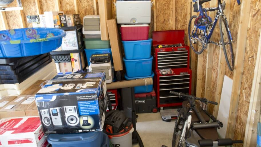 Interior of garage with kiddie pool, bike and other items. (Photo by Photo by Eldon Lindsay)