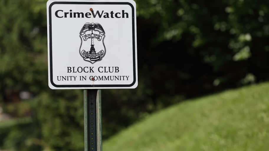 crime watch sign in neighborhood