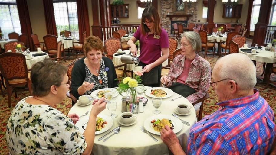 Residents dine together at a nursing home.
