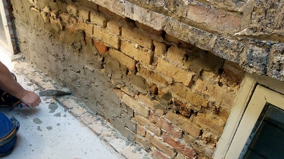 an old brick wall under repair