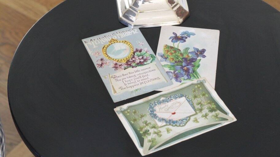 vintage postcards decoupaged on side table