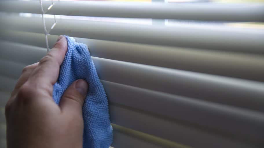 wiping down blinds