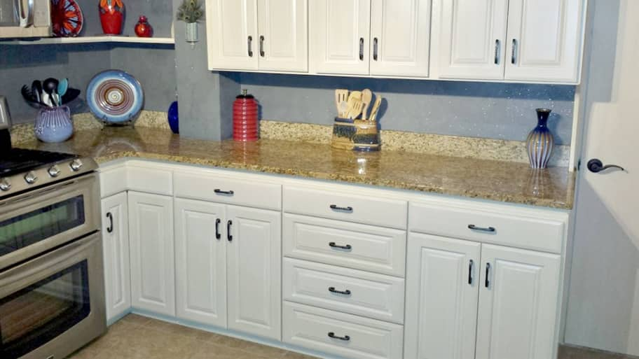 When to Refinish Kitchen Cabinets Instead of Refacing ...
