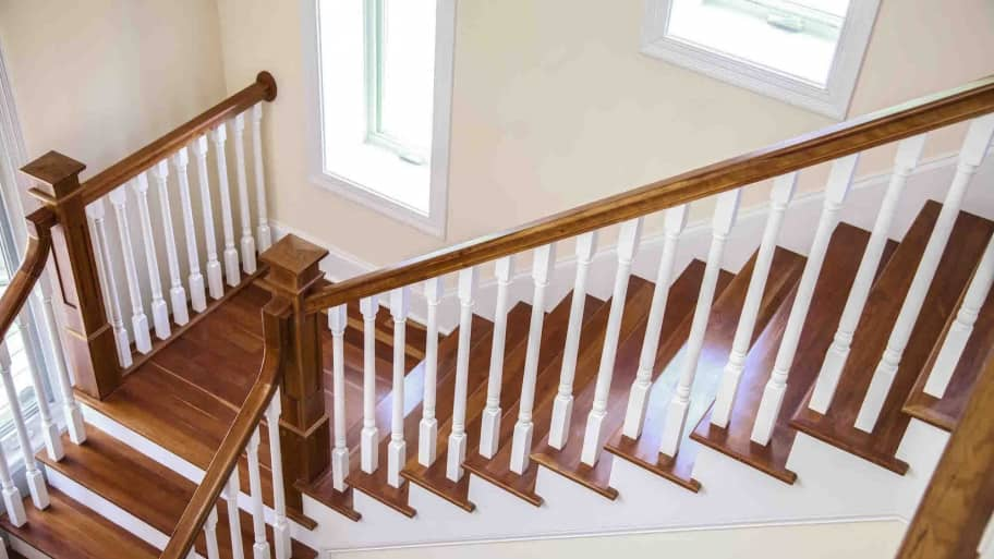 Staircase With Painted Spindles And Stained Stair Treads