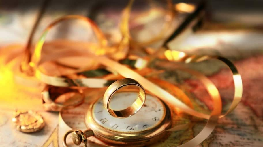 gold pocket watch, wedding band, and chain