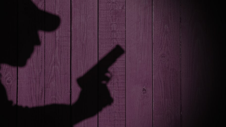 shadow of robber with gun