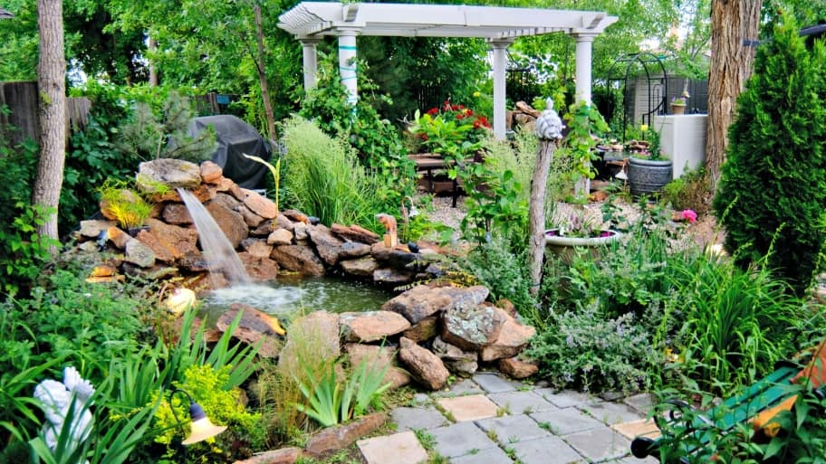 How to add fountains ponds and waterfalls to your for Putting a pond in your backyard