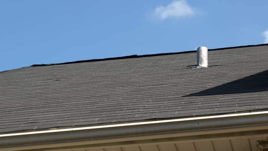 asphalt shingle roof and plumbing vent