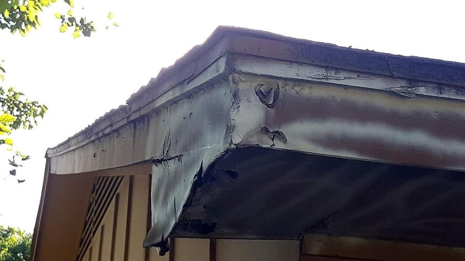 rotted siding on an old house