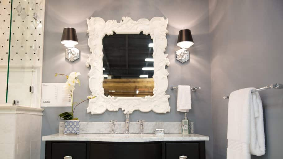 Bathroom Vanity With Decorative Mirror And Light Sconces