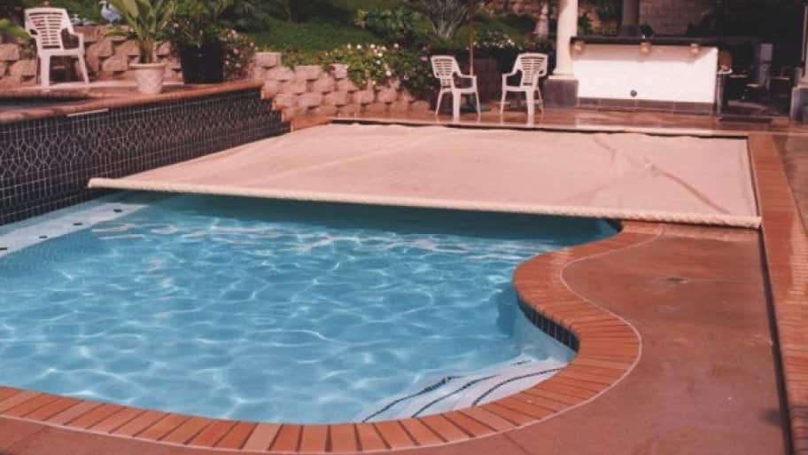 swimming pool with child proof safety cover