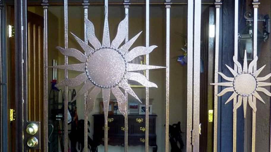 Secure Front Door With Metal Sun Design
