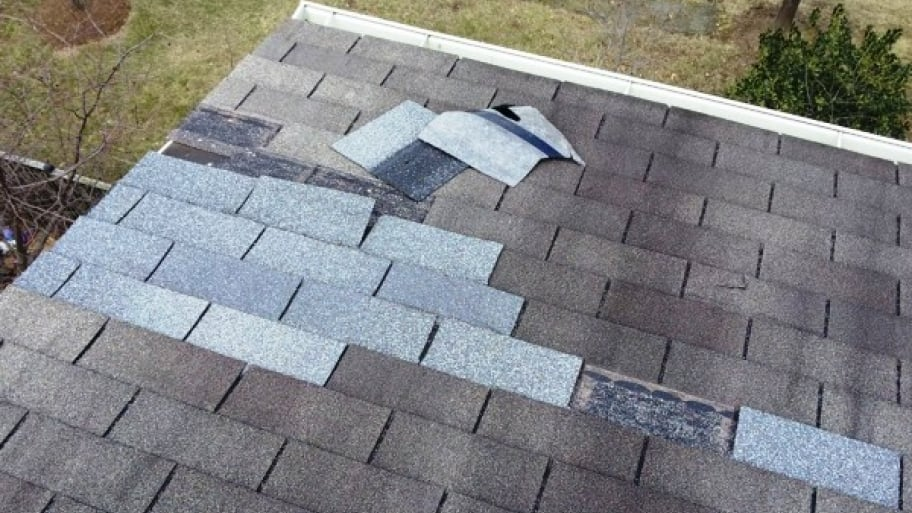 A little more than a month after a company replaced this member's shingles, they came loose and landed the company in the Angie's List Penalty Box. (Photo courtesy of Angie's List member Laura A. of Sterling, Va.)