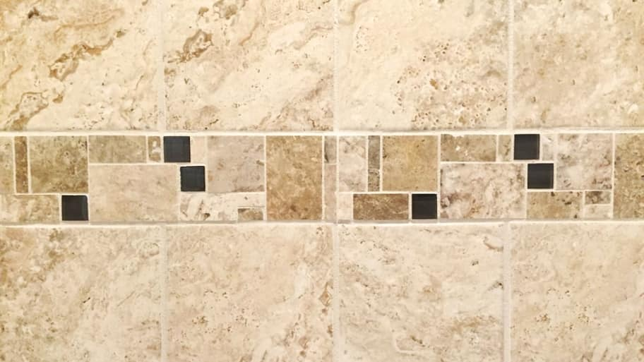 If you have a leak in your shower caused by missing grout, you can scrape out any loose material and regrout the area. (Photo courtesy of Angie's List member Rachel L. of Philadelphia)