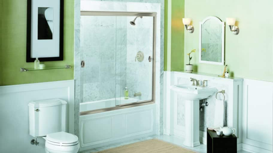 bathroom with gray tile shower and bypass shower doors