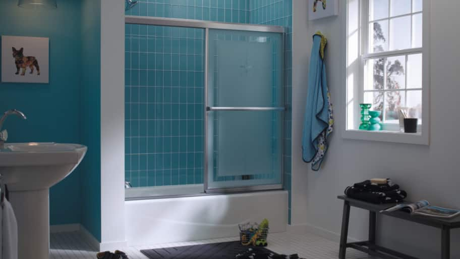 blue tile bathroom with tub/shower combination