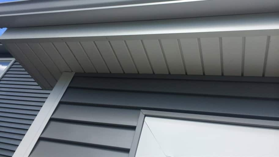 siding, a gutter and a window on a house