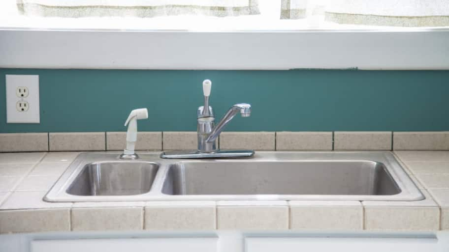 how to fix the spray hose on your kitchen sink angie s list rh angieslist com