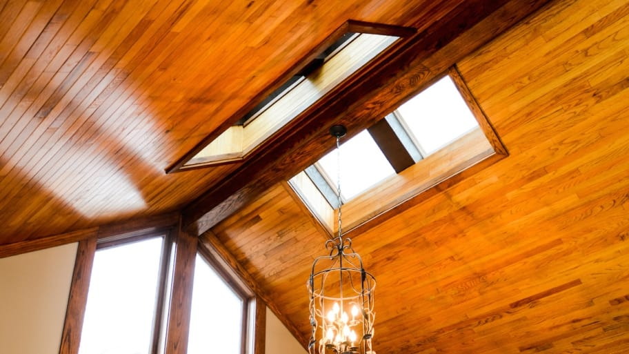 skylights in wood-covered ceiling