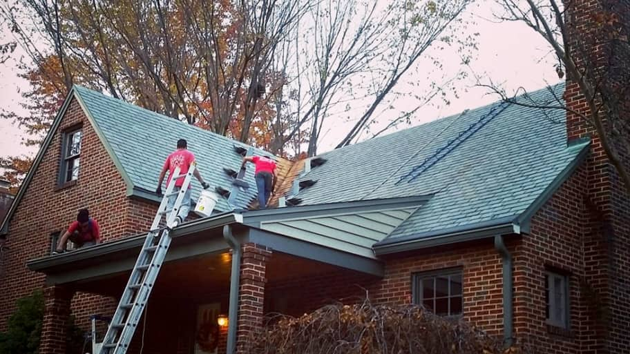 roofers installing new roofing on a home