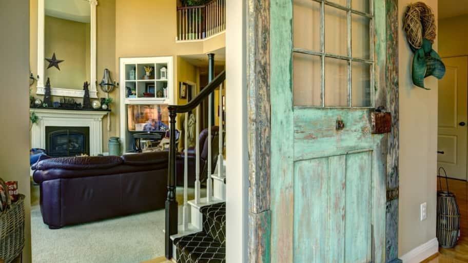 blue barn door used inside kitchen remodel