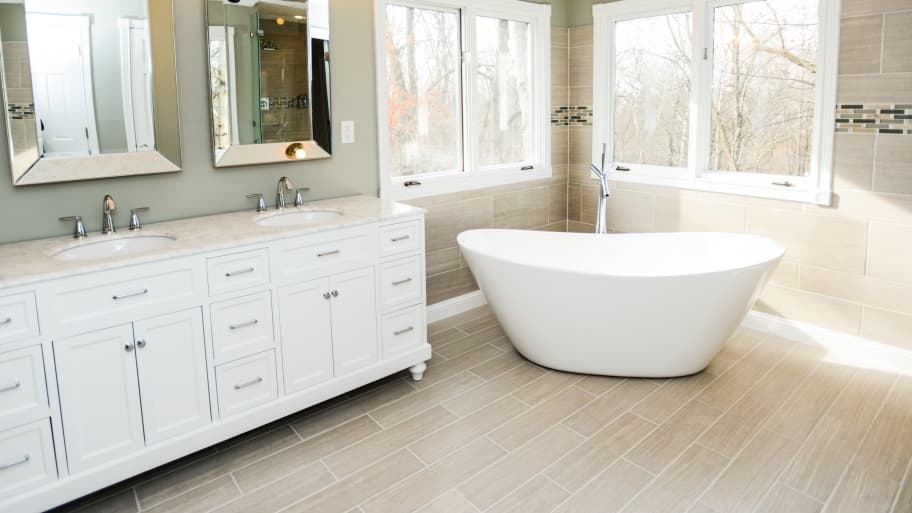 soaker tub in bathroom with tile floor