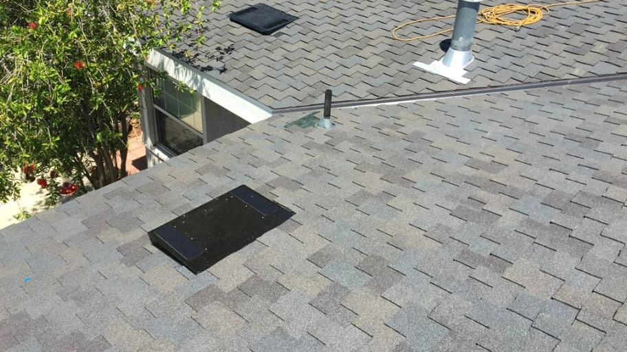 solar attic fans and vents on shingle roof