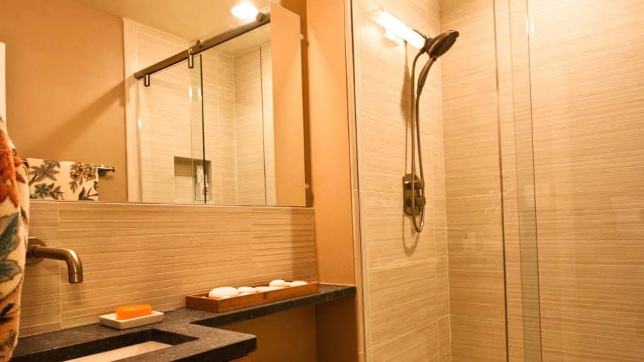 bathroom shower beige floor to ceiling tile