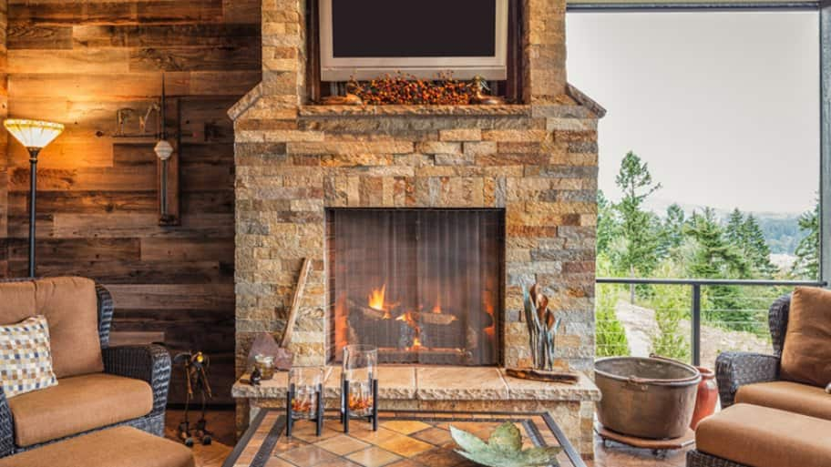 Brown, stone fireplace as focal point of living room
